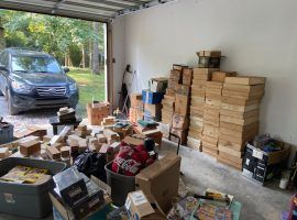 My garage after unloading my 1 million card find. It's unclear when I will park my car in here again. (Image: Johnny Kampis)