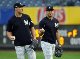 If outfielders Aaron Judge and Giancarlo Stanton can remain healthy this season for the New York Yankees, they'll have a shot at exceeding their projected win totals. (Image: Porter Lambert/Getty)