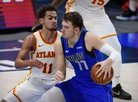Trae Young of the Atlanta Hawks defends Dallas Mavericks star Luka Doncic, but couldn't stop Luka from tallying a seventh triple-double this season. (Image: Jerome Miron/USA Today Sports)