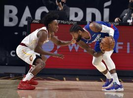 Collin Sexton of the Cleveland Cavs is seen here guarding Paul George from the LA Clippers. The Clippers face two elite squads this weekend with games against the Brooklyn Nets and Utah Jazz. (Image: Getty)
