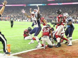 The New England Patriots celebrate after scoring a touchdown in overtime to defeat the Atlanta Falcons in Super Bowl LI. (Image: Getty)