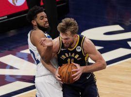 Karl-Anthony Towns of the Minnesota Timberwolves defends Indiana Pacers forward Domantas Sabonis. Sabonis recorded his third triple-double of the season. (Image: Brad Rempel/USA Today Sports)