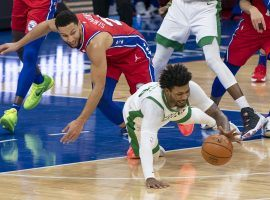 Boston Celtics guard Marcus Smart, seen here diving for a loose ball against point guard Ben Simmons from the Philadelphia 76ers. The Sixers are now co-favorites to win the Atlantic Division. (Image: Chris Szagola)