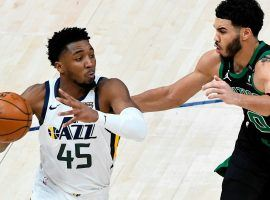 Donovan Mitchell, Utah Jazz guard seen here driving against Boston Celtics star Jayson Tatum, leads the red-hot Utah Jazz to a 16-1 record over their last 17 games. (Image: Getty)