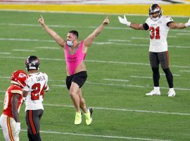 Bovada has voided many bets on its Super Bowl streaker prop bet, after Yuri Andrade (center) gave interviews revealing a planned effort to win money by running on the field. (Image: Kim Klement/USA Today Sports)