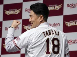 Ex-Yankees starter Masahiro Tanaka shows off his new jersey after he signed a contract with the Tohoku Rakuten Golden Eagles. (Image: Eugene Hoshiko/AP)