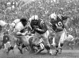 Baltimore Colts QB Johnny Unitas, seen here evading the NY Giants in 1959, is one of the greatest QBs in the history of the NFL. (Image: Neil Leifer/AP)