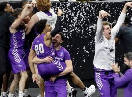 Members of #14 Abilene Christian celebrate their upset victory over #3 Texas in the first round of 2021 March Madness (Image: Getty)
