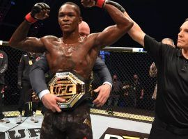 Israel Adesanya (pictured) will try to become the latest two-division champion in the UFC when he takes on light heavyweight champion Jan Blachowicz at UFC 259. (Image: Josh Hedges/Zuffa)