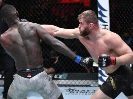 Jan Blachowicz (right) defeated Israel Adesanya (left) to retain his light heavyweight title in the main event of UFC 259. (Image: Jeff Bottari/Zuffa/Getty)