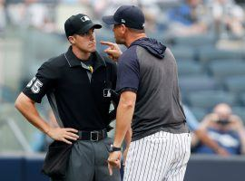New York Yankees manager Aaron Boones rants at home plate umpire Brennan Miller after he ejected Boone in a game against the Tampa Bay Rays in July 2019. (Image: Kathy Willens/AP)