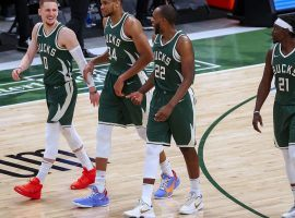 The Milwaukee Bucks are all smiles during their eight-game winning streak, which propelled them within striking distance of the #1 seed in the Eastern Conference. (Image: Dylan Buell/Getty)