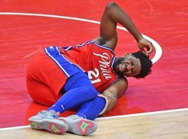Philadelphia 76ers center Joel Embiid moments after his leg buckled after a dunk against the Washington Wizards at the Wells Fargo Center. (Image: Brad Mills/USA Today Sports)