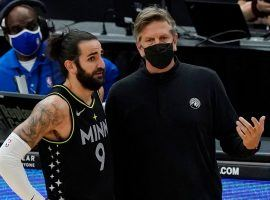 Minnesota Timberwolves point guard Ricky Rubio and new head coach Chris Finch have a quick on-court discussion during the T-Wolves' recent losing streak. (Image: Dave Algonquin/Getty)