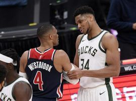 Russell Westbrook and Greek Freak have a post-game chat after both players scored a triple-double when the Milwaukee Bucks defeated the Washington Wizards. (Image: Nick Wass/AP)