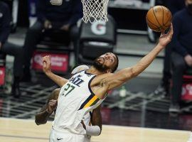 Rudy Gobert, the favorite to win the NBA DPOY, pulls down a rebound for the Utah Jazz against the LA Clippers. (Image: Marcio Jose Sanchez/AP)