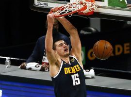 Nikola Jokic, seen here dunking in a game for the Denver Nuggets, has become the new favorite to win the MVP this season. (Image: Winslow Townsend/USA Today Sports)