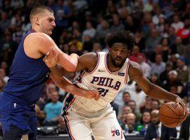 Denver Nuggets big man Nikola Jokic, seen here defending Philadelphia 76ers center Joel Embiid, is one of the odds favorites to win the NBA MVP this season. (Image: Matthew Stockman/Getty)