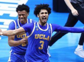 UCLA sophomore swingman Johnny Juzang celebrates an upset victory over #1 Michigan in the Elite 8. (Image: Mark J. Rebilas/USA Today Sports)