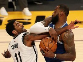 Kyrie Irving of the Brooklyn Nets defends LeBron James from the LA Lakers. (Image: Katelyn Mulcahy/Getty)