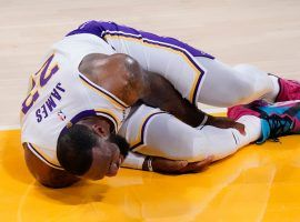 LA Lakers star LeBron James clutches his leg after suffering an ankle injury against the Atlanta Hawks. (Image: Joel Smith/Getty)
