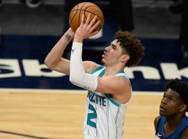 LaMelo Ball of the Charlotte Hornets shoots a jumper while Anthony Edwards of the Minnesota Timberwolves looks on. (Image: Getty)