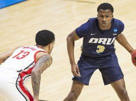 Oral Roberts sophomore Max Abmas, seen here against Ohio State in the first round of March Madness, leads the nation in scoring. (Image: Robert Franklin/AP)
