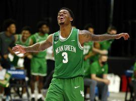 North Texas star Javion Hamlet celebrates an overtime victory over Western Kentucky in the Conference USA championship game. (Image: Tim Heitman/USA Today Sports)