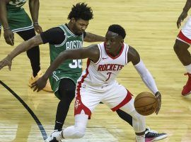 Houston Rockets guard Victor Oladipo dribbles through a trap by the Boston Celtics. (Image: Troy Taormina/AP)