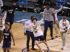 The Oral Roberts Golden Eagles celebrate a major upset as a #15 seed with a victory over #7 Florida in the second round of March Madness. (Image: Doug McSchooler/USA Today Sports)