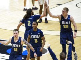 Oral Roberts celebrates a major upset victory over Ohio State, ranked #7 in the country, in the first round of the March Madness college basketball tournament. (Image: Getty)
