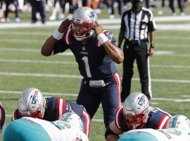 Quarterback Cam Newton runs a red zone offense for the New England Patriots against the Miami Dolphins in Week 1. (Image: Winslow Townson/AP)
