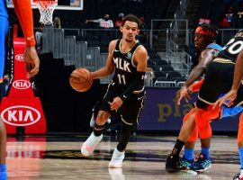 Trae Young of the Atlanta Hawks evades defenders in transition against the Oklahoma City Thunder. (Image: Scott Cunningham)