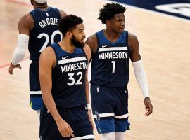 Karl-Anthony Towns and rookie Anthony Edwards of the Minnesota Timberwolves discuss strategy in a recent game during their losing streak. (Image: Will Newton/Getty)