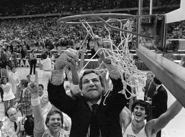 Dean Smith, head coach of North Carolina, cuts down the net after winning the 1982 college basketball championship. (Image: AP)
