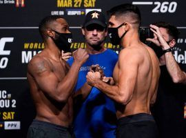 Vincente Luque (right) says he won't underestimate former champion Tyron Woodley (left) at UFC 260. (Image: Jeff Bottari/Zuffa)