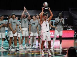 Jalen Suggs, freshman guard from Gonzaga, holds the WCC tournament championship trophy after Gonzaga defeated BYU at the Orleans Arena in Las Vegas. (Image: Kirby Lee/USA Today Sports)