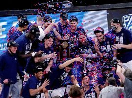 Gonzaga Bulldogs, seen here celebrating their victory in the Elite 8 to snag a spot in the 2021 Final Four, are the consensus betting favorites to win March Madness. (Image: Porter Lambert/Getty)