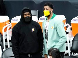 Banged-up LeBron James and Anthony Davis support their LA Lakers teammates from the bench. (Image: Getty)