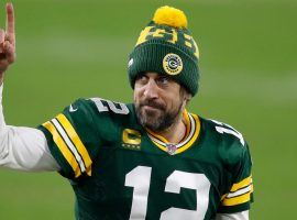 Aaron Rodgers celebrates a Green Bay Packers playoff victory at Lambeau Field, but will the Packers honor his trade request? (Image: Matt Ludtke/AP)