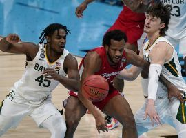 Baylor guards Davion Mitchell (45) and Matthew Mayer (24) swarm Houston's Justin Gorman in a Final Four victory. (Image: Michael Conroy/AP)