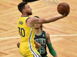 Golden State Warriors guard Steph Curry, seen here driving for a layup against the Boston Celtics, is the hottest player in the NBA right now. (Image: Harris Krane/Getty)