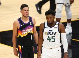 Phoenix Suns guard Devin Booker guards Donovan Mitchell of the Utah Jazz in a meeting between the top two teams in the NBA. (Image: Mark J. Rebilas/USA Today Sports)