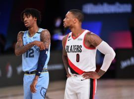 Ja Morant and Damian Lillard meet each other twice this weekend when the Portland Trail Blazers host the Memphis Grizzlies in games that have postseason implications. (Image: Jesse D. Garrabrant/Getty)