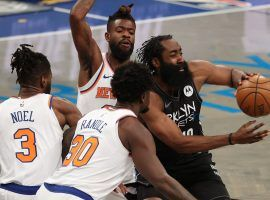 James Harden of the Brooklyn Nets, seen here being swarmed by the New York Knicks, will miss at least 10 days with a hamstring injury. (Image: Al Bello/Getty)