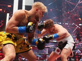 Jake Paul (left) delivered a brutal first-round knockout over Ben Askren (right) in their boxing match on Saturday night. (Image: Getty)