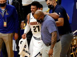 Jamal Murray suffered a torn ACL during Monday's game against the Golden State Warriors, an injury that could sink the Denver Nuggets' title hopes. (Image: Getty)