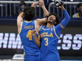 Jaime Jaquez Jr. (4) and Johnny Juzang (3), seen here celebrating an overtime victory for UCLA over Alabama in the Sweet 16, are the primary scorers for the Bruins heading into the Final Four. (Image: Michael Conroy/AP)