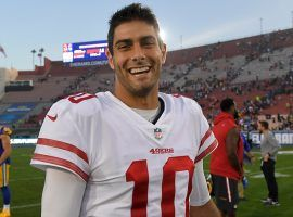 San Francisco 49ers quarterback Jimmy Garoppolo celebrates a victory over the LA Rams. Jimmy G is mentioned in the latest batch of NFL trade rumors with the 2021 NFL Draft rapidly approaching. (Image: Mark J. Terrill/AP)