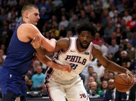 Nikola Jokic of the Denver Nuggets, seen here guarding Joel Embiid from the Philadelphia 76ers, is the front runner to win NBA MVP this season. (Image: Matthew Stockman/Getty)